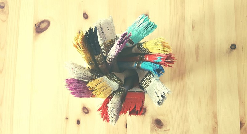 Paint brushes with all colors of the rainbow