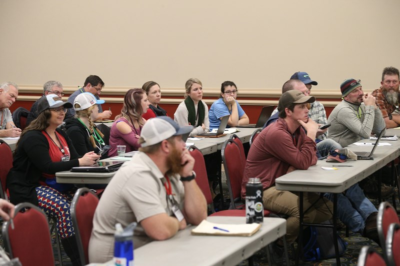 marketers take notes at the America Outdoors Conference